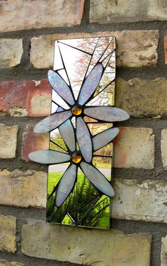 Mosaic garden mirror Handmade with iridescent stained glass, recycled mirror and glass nuggets. Mosaic Flowers, Stained Glass Flowers, Stained Glass Designs, Stained Glass Patterns, Stained Glass Art, Broken Glass Art, Sea Glass Art, Glass Wall Art, Mosaic Artwork