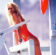 I'll Be Ready: Baywatch's Red Swimsuit Trend Is Back via @WhoWhatWearUK