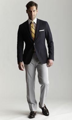 Navy sport coat, yellow stripe tie, light grey trousers