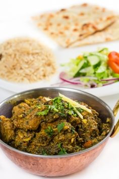 Pureed spinach and lamb cooked with garlic, spices and herbs. Spices And Herbs, Stavanger, Lassi, Chicken Nuggets, Butter Chicken, Biryani, Naan, Pepperoni, Spinach
