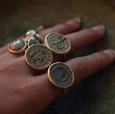Karen Liberman antique Roman coins gold rings and raw diamond ring.