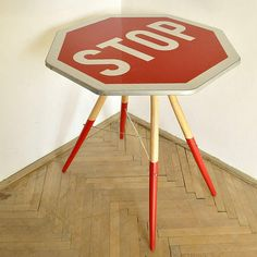 Studio Repa, founded in 2009 by Juro Vyboh, created a fresh and colourful table made out of old chair legs and a used STOP traffic sign.