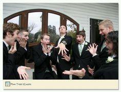 Lol Groom (showing off ring) & grooms men Wedding photo