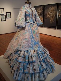 """Brooklyn Day Dress by Meridith McNeal. NYC Transit maps and mannequin. Part of a 2009 exhibition at the Christopher Henry Gallery in NYC,  co-curated by Christopher Henry and Katherine Harmon. Harmon is the author of many art books, including """"Map as Art: Contemporary Artists Explore Cartography."""""""
