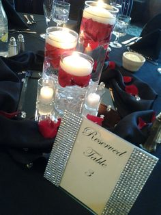 Cylinder Vases with Red rose petals and floating candles. Wedding centerpieces, Black & Red Wedding, Red & Black Wedding, Wedding Bling, www.rockwoodsgrill.com, Otsego MN