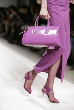 A model wears a purple creation for Max Mara women's Spring-Summer 2014 collection during Milan Fashion Week.   Read more: http://www.nydailynews.com/life-style/fashion/color-year-2014-radiant-orchid-article-1.1538506#ixzz2mjPArNkH