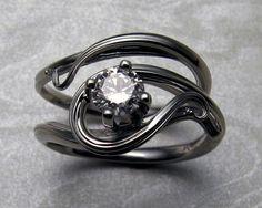 Free-form, art nouveau style engagement ring set.