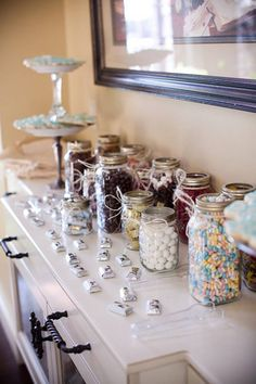 What a fun idea for weddings with kids!  Have a Candy Bar.  We had a cookie bar at my sisters wedding. It included jars of different family recipe cookies, wax bags with wedding labels. People LOVED it! What an idea!