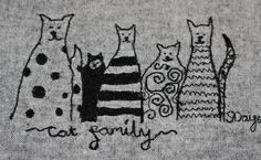 The cat family in freehand machine embroidery.