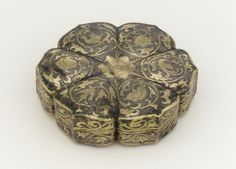 Covered box in the form of a six petalled flower with birds and floral scrolls. China, Shaanxi Province. Hammered silver with repousse, chased and ring-punched decoration and mercury gilding. Mid Tang Dynasty - Late 7th century - early 8th century.  Freer Gallery - The Smithsonian's Museum of Asian Art.