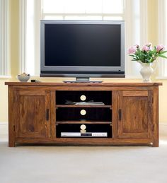 """""""LifeEstyle Sheesham Wood Plazma Tv Unit With Storage A beautiful display for your television, this stunning Sheesham Wood Plasma Stand provides a perfect blend of utility with its multiple cabinets and shelves. A smooth sheesham base accented by a d Tv Display Unit, Tv Storage Unit, Storage Spaces, Tv Cabinets With Doors, Cabinet Doors, Units Online, Tv Unit, Media Unit, Can Design"""
