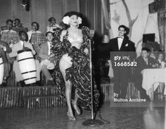 Caption:A Cuban rhumba dancer named Zulema performs on stage with a band at the Zombie Club on Zulueta Street, Havana, Cuba, February 16, 1946