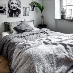Mid-sized danish master bedroom photo in Other with gray walls and dark hardwood floors.    Double tab for more images.  #fortheloveoflinen #linen #bedlinen #tellmemore #interior4all #linenbedding #pureline #purelinenutrition #interiordecor #bedroomdecor #bedroominspiration #handmade #handmadebedding  #tailoredmade #instadaily #greywalls #hardwoodflooring #greybedding #greybedroom #graybedroom