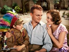 James Cagney and the little Rascals boy in a scene from a 1930s film.