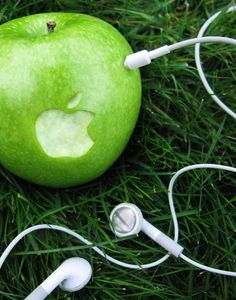 I like this image because the logo is placed on an actual Apple. The headphones make the image amusing.