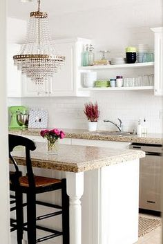 open shelving over sink where window is missing, (possibly pots and pans hanging below?) -