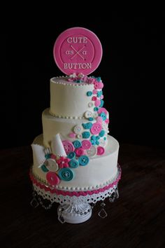 Button Cake - A friend brought me a picture of this design that I believe was first created by Miso Bakes from the research I did. I LOVE the button theme and I added textured buttons and a gumpaste bow. Two tiers are french vanilla cake and one is fresh strawberry. All decorations are fondant or gumpaste.