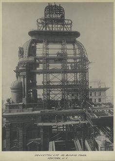Broadway near Wall Street.. the widening of the cupola of the Manhattan Life Insurance Co. Bldg... the lower structure had its width doubled.. 1908