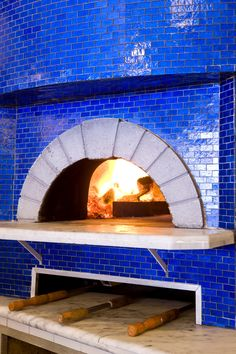 Blue Brick Oven Commit to a color and create a beautiful focal point in the back yard.