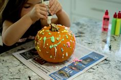 No Carve Pumpkin Decorating with Glow-In-the-Dark Paint 2021 - Entertain Your Toddler No Carve Pumpkin Decorating, Pumpkin Carving, Bubble Recipe, Painted Pumpkins, The Darkest, Christmas Bulbs, Bubbles, Glow, Arts And Crafts