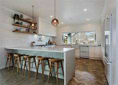 A stunning traditional style kitchen in the heart of a beautiful home.