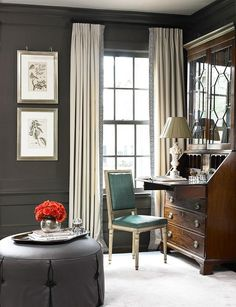 dark charcoal walls, light curtains with greek key trim and leather chair...love this room