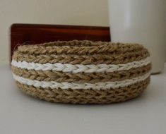 Add a simple cottage-style organizing element to any space with this sweet little crocheted basket. Crocheted from jute twine, with a cotton