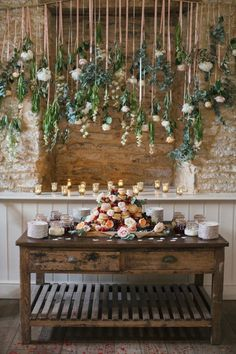 dessert table with hanging flowers - 20 of our Most Pinned Weddings - photo by Hayley Savage http://ruffledblog.com/20-of-our-most-pinned-weddings