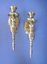 Solid Brass Wall Candle Sconces Swirled Urn Post Set of 2       Product Description  This set of Grecian Style Sconces are made of a solid brass form, not brass plated and will add warmth and style to your decor for your family to enjoy in your own home. Measures a stately 9.75 inches tall, 2.75 inches wide, and projects 4 inches from wall. Match them up with a great pair of Peg Votive Holders (Sold here separately). Lacquered With A Heavy Duty, Non-Tarnish Finish.