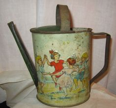 "Vintage German Embossed Tin Watering Can Sand Toy....Children Playing ""Ring Around the Rosey""."
