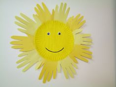 Instead of cutting out ALL those handprints, glue a yellow painted circle on white paper, paint hands yellow and go around circle.