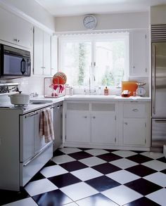 simple 1950s kitchen remodel, checkerboard floor tile, laminate countertops paired with sub zero fridge