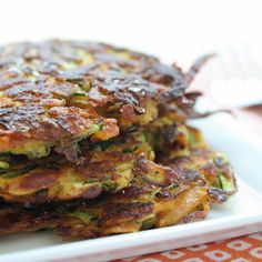 Zucchini & Sweet Potato Latkes - Easy to make and perfect with breakfast or dinner!  Great recipe, made it for dinner, I used regular flour though. BE MINDFUL: cook them, slightly under medium heat and let cook until golden brown, that way you can ensure they are thoroughly cooked. I had them on too high of heat the first time around, great crisp, but undercooked in the middle.
