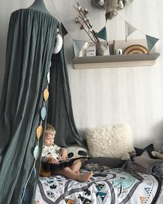 Inspiring and cozy reading corner! Numero74 canopy in ice blue!