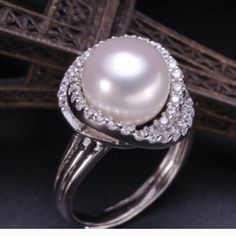 FRESH WATER ADJUSTABLE RING. PRICE FIRM. Brand new ! Set in 925 beautiful freshwater Pearl. Adjustable to your size. Jewelry Rings