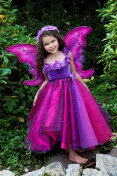 The Deluxe Wildflower Faerie Includes:    •Convertible Faerie Skirt/Dress  •Rose Bodice  •Hand Painted Wings  •Handmade Organza Rose Garland •Tulle