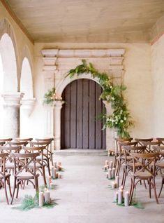 asymmetrical garland, candlelit aisle & wood cross-back chairs