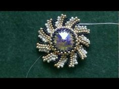 Video: Beading4perfectionists : Swarovski Rivoli sunray Bezel pattern #Seed #Bead #Tutorials