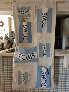 toms shoe holder. i have enough toms stuff that i could definitely do this