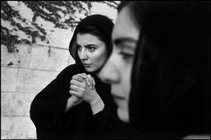 Abbas-  IRAN. Under Pt KHATAMI. 1997. - IRAN. Tehran. 1997. Film actress Leyla HATAMI (left) with a friend. Both wear the veil, compulsory under the Islamic Republic. - Asian - Other Asian origin, Exterior, Hand, HATAMI Leyla, Inscrutable (face), Islamic scarf, Portrait, Profile, Tehran (city), Two people, Veil (religious), Woman - 25 to 45 years