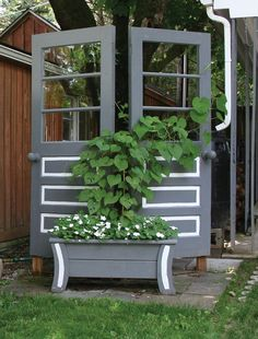 Two doors and a modern wooden planter were painted to provide a trellis for the plants and a screen to hide the rain barrel behind. Garden Trellis, Garden Gates, Garden Art, Garden Ideas, Patio Ideas, Backyard Ideas, Recycled Door, Repurposed, Outdoor Living