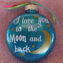 "This+listing+is+for+one+4""+glittered+glass+ornament+with+the+verse+""I+love+you+to+the+moon+and+back""+accented+by+moon+and+stars.++This+is+an+m&m-shaped+ornament,+and+the+detail+is+done+in+top+quality+vinyl.++The+glitter+is+safely+inside+the+ornament.The+lettering+is+done+in+white+vinyl.++A+name+c..."