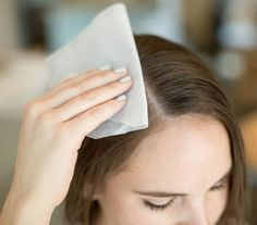 Just like you'd use a blotting paper to remove excess oil on your skin, you can do the same for your hair. But, if you're in a pinch and don't have any blotting papers handy, grab a clean toilet seat cover from the restroom and blot your hair instead. They're made out of similar material as blotting papers, which means they can help sop up excess oil just as well.