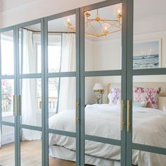 an IKEA Pax wardrobe with fully mirrored front panels with aqua frames and brass. - Home Decor -DIY - IKEA- Before After Ikea Closet Doors, Mirrored Wardrobe Doors, Mirror Closet Doors, Ikea Pax Doors, Entryway Closet, Ikea Mirror, Ikea Wardrobe Hack, Ikea Pax Hack, Bedroom Wardrobe