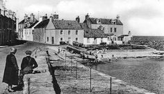 Tour Scotland Photographs: Old photograph of cottages and people by the harbour in Cellardyke in the East Neuk Fife, Scotland. Cellardyke was formerly known as Nether Kilrenny