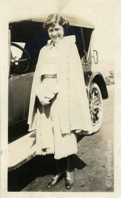 Downtown – 1920. Icon #2 wears a blouse, a full high waist skirt, a cape, and monk-strap shoes. www.caughtwalk.com