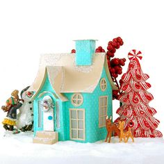 Quinn is a quaint little Christmas village cottage where forest animals feel safe to roam.  Made from cardstock & glitter.  Dimensions; 5 x 3.5 x 3″