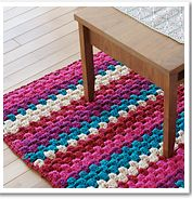 Here's a quick project - done on a bulky cotton yarn (two strands at once) - great little rug or bath mat.  Easy and quick and FREE! http://www.ravelry.com/patterns/library/ami-cotton-striped-rug
