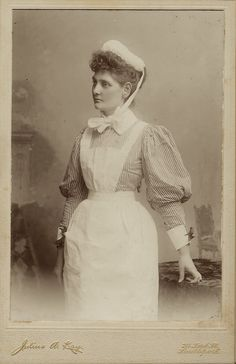 A portrait of a domestic worker in Southport, England. She is attractive and wearing a fine housekeepers uniform. It seems apparent that she worked for...