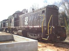 this is the only one of the three with a two digit number   Description:    Photo Date:  2/15/2003  Location:  Troy, AL   Author:  Ken Roble  Categories:    Locomotives:  COEH 52(SW1500)